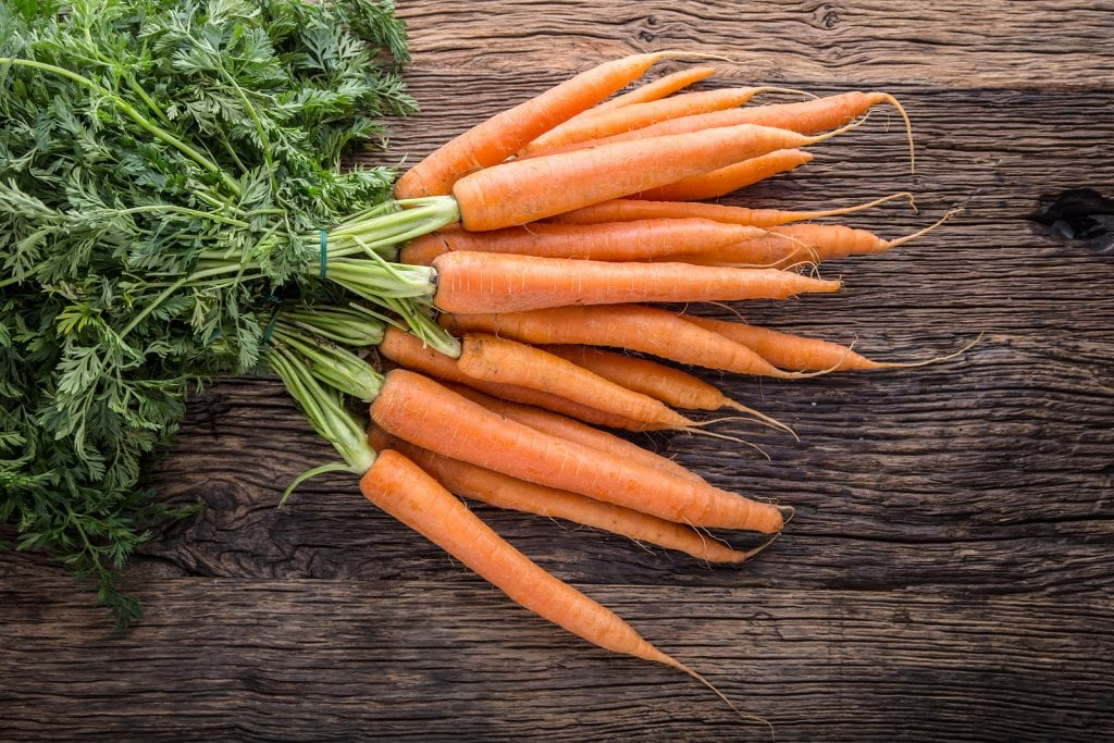 Carrots are high in fiber which stimulates saliva production