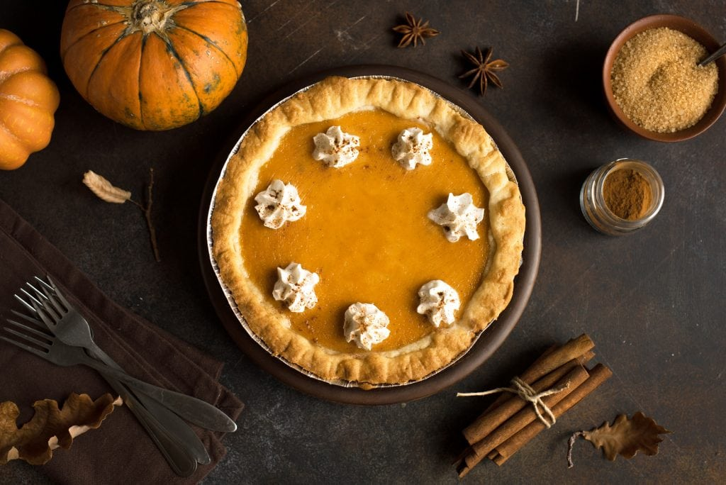Pumpkin pie with shipped cream and cinnamon