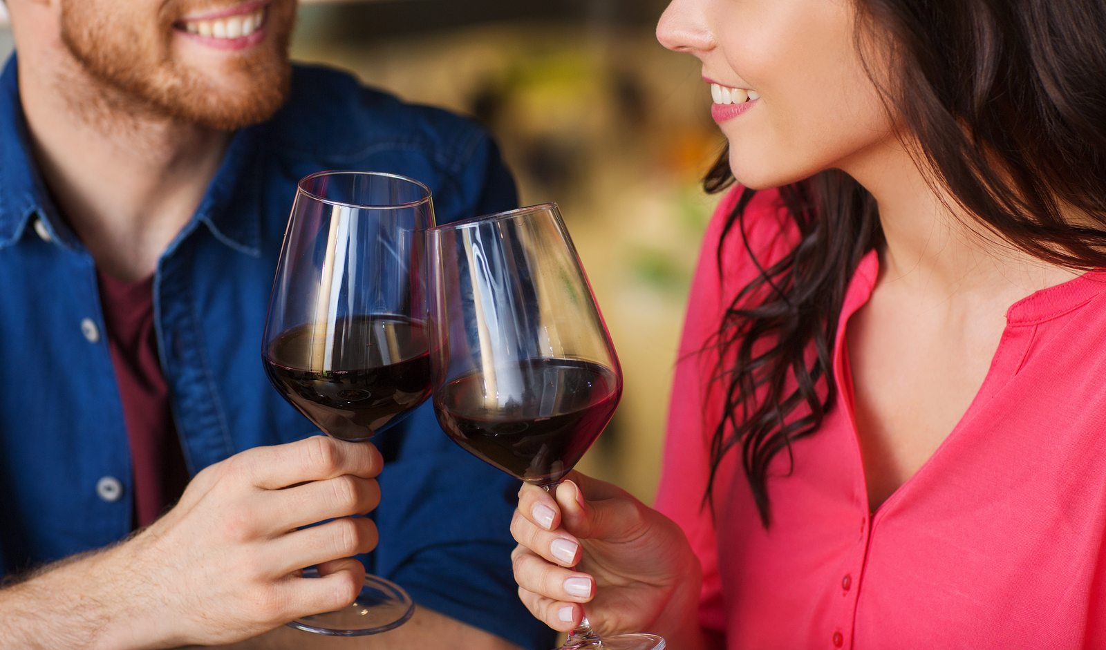 leisure, celebration, food and drinks, people and holidays concept - smiling couple having dinner and drinking red wine at date in restaurant