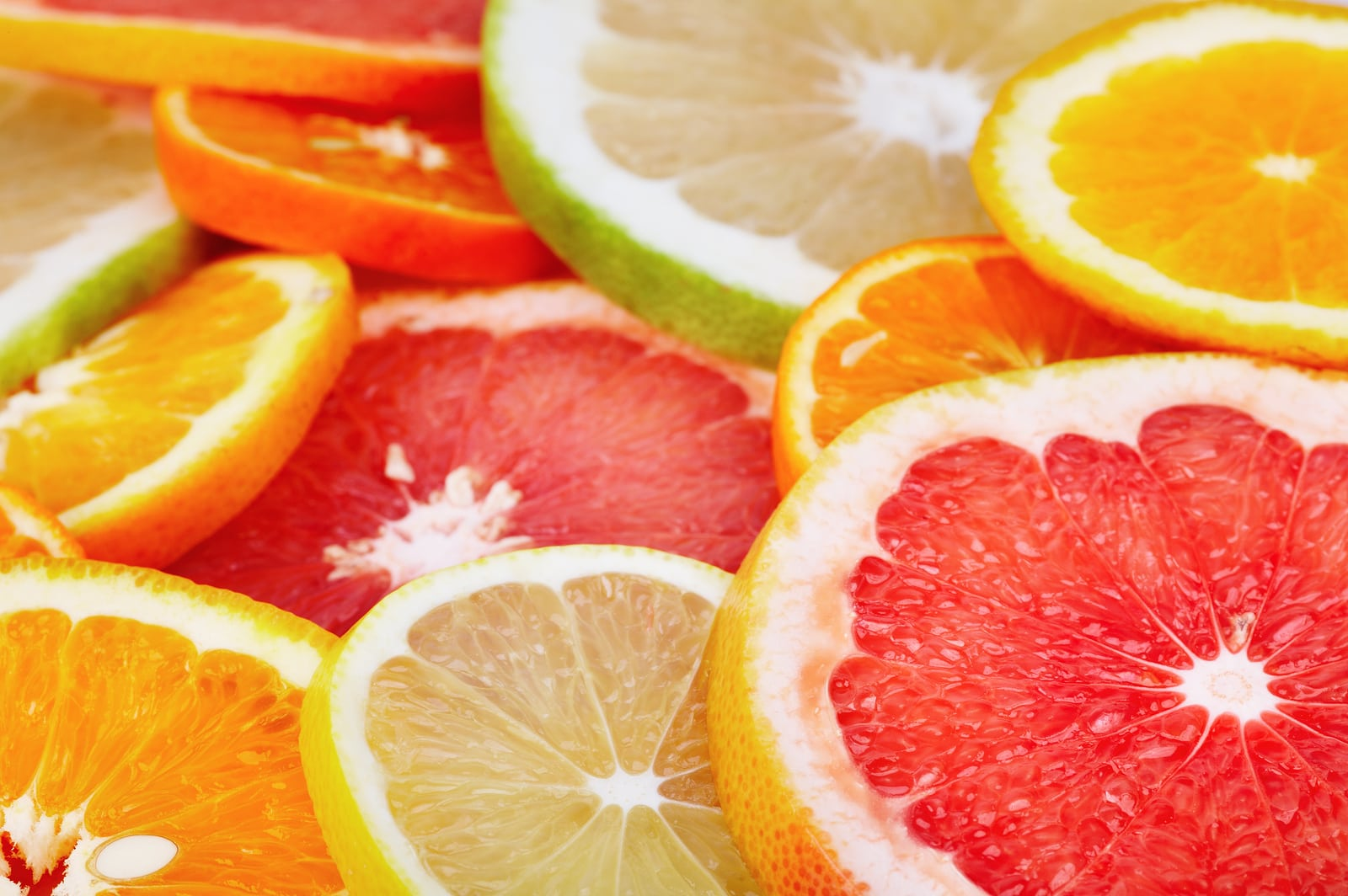 Sliced citrus fruits closeup