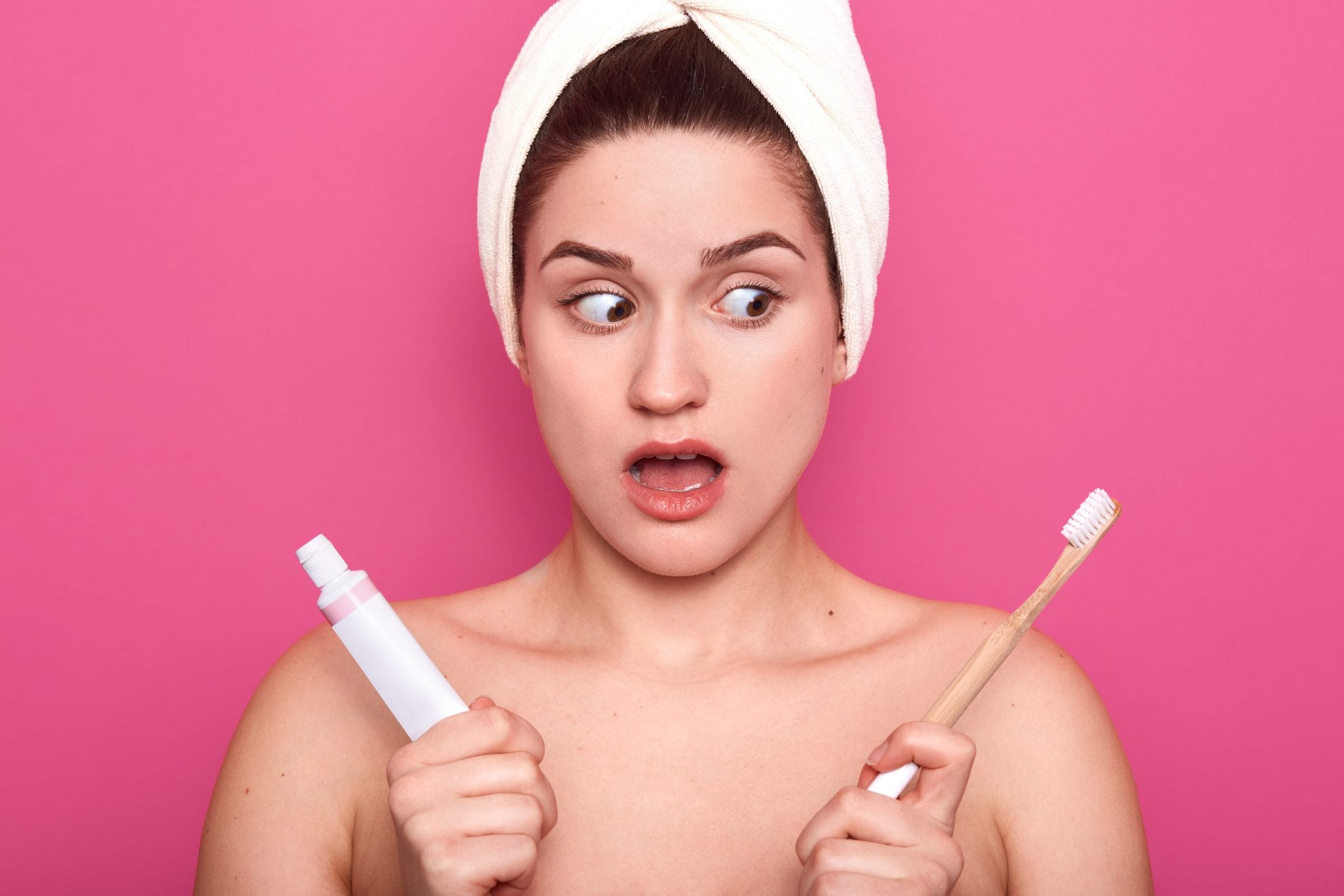 Woman out of the shower surprised with toothbrush and paste